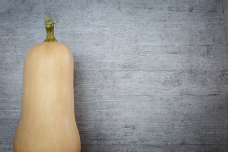butternut squash: Butternut squash on grunge wood background Stock Photo