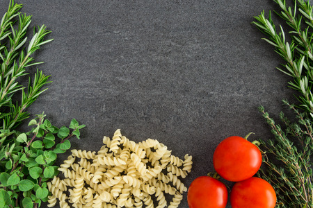 Pasta tomatoes thyme oregano rosemary herbs photo