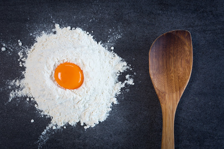 stone background: Flour egg wooden spoon baking Stock Photo