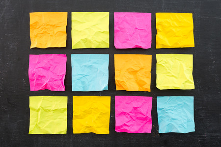 Blank crumpled colorful sticky notes photo