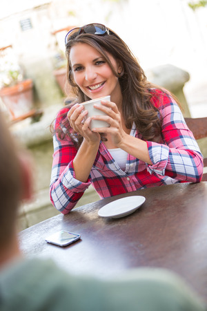 Couple drinking coffee at cafe photo