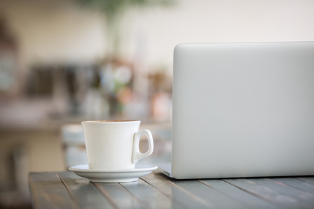 coffe cup: Laptop computer and coffe cup