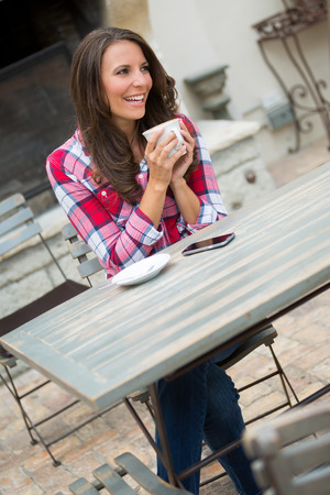 20 30: Beautiful happy woman drinking coffee Stock Photo
