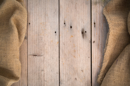 coffee sack: Burlap and wood board background