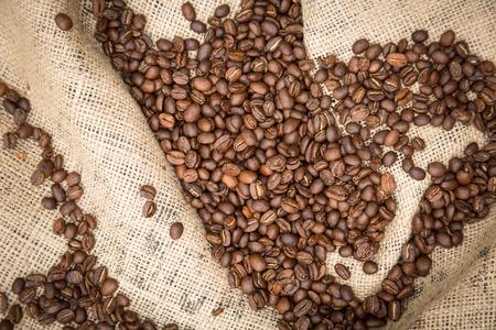 decaffeinated: Coffee beans in burlap sack