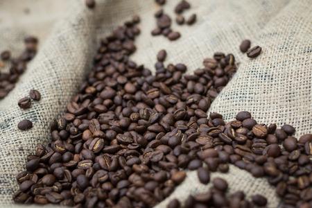decaffeinated: Pile of coffee beans on burlap sack Stock Photo