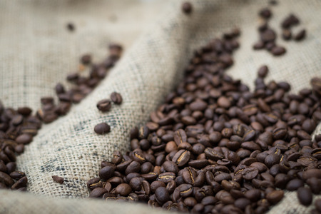 caffeinated: Pile of coffee beans on burlap sack Stock Photo