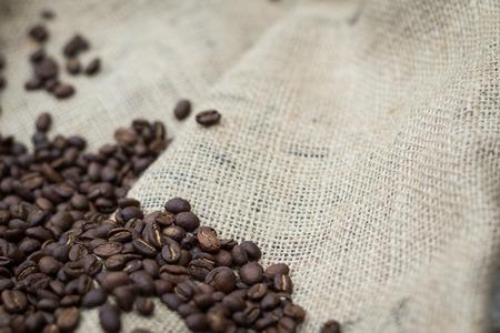 caffeinated: Pile of coffee beans on burlap sack Stock Photo