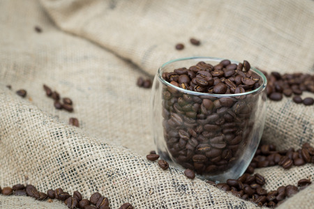 caffeinated: Coffee beans in a glass cup