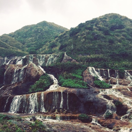 goldmine: Waterfalls in forest where was a goldmine at jiufen Taiwan