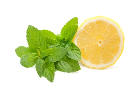 Yellow lemon with mint on a white background