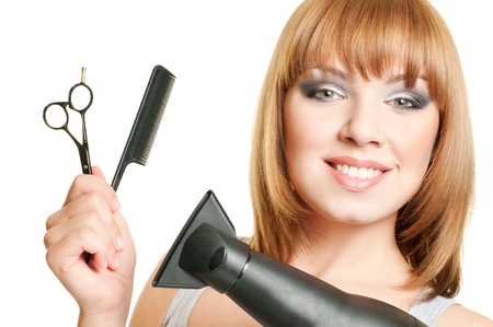 Attractive girl with hairdressers tools isolated on white background
