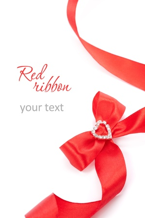Red gift ribbon bow with heart on white background
