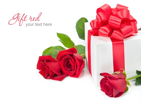 Red roses with gift-box on white background