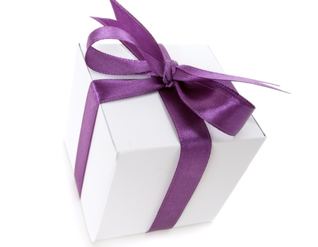 White box with purple ribbon on white background Stock Photo