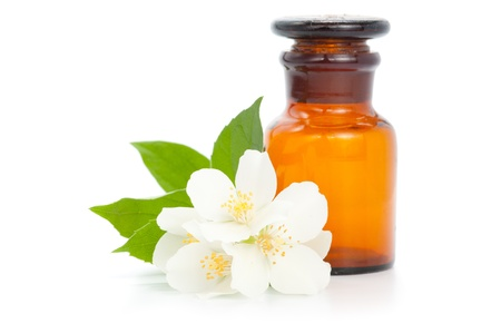 Aromatherapy. Jasmine with bottle isolated on white background Imagens