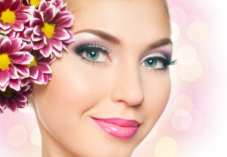 Woman face with bright makeup photo