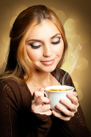 Beautiful Woman with cup of Coffee Stock Photo - 11299365