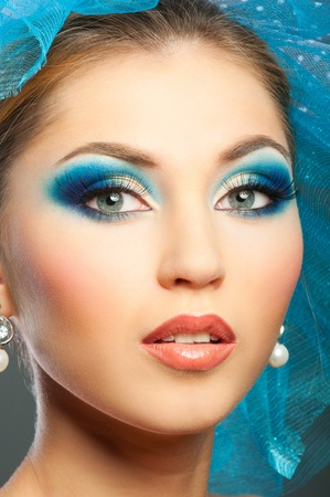 Woman face with bright blue makeup Imagens