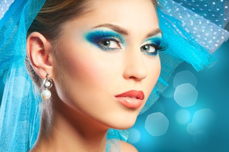 close up eyes: Portrait of young woman with blue make-up