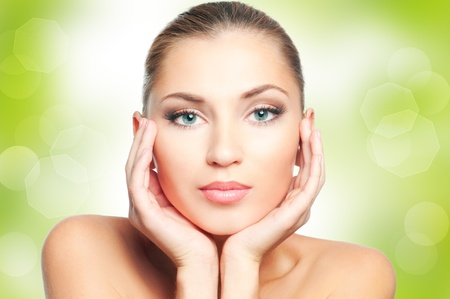 natural cosmetics: Beautiful woman face on green nature background