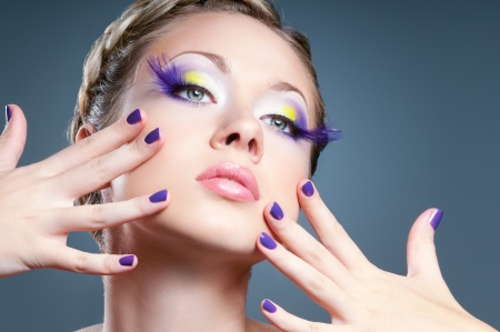 Woman face with bright violet makeup