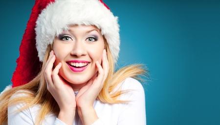 Joyful shocked woman in Santa hat