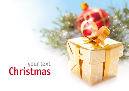 Golden Christmas gift over white background with space for your text Stock Photo