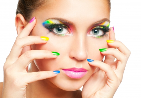 Woman face with rainbow makeup