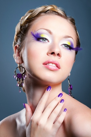 Woman face with bright violet makeup and manicure Stock Photo - 12047289