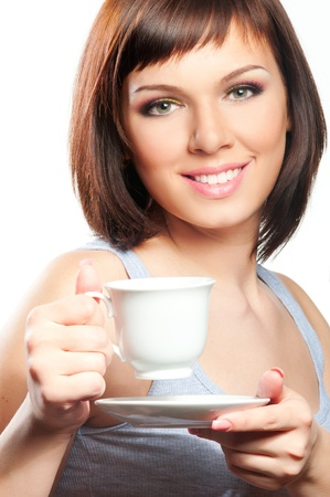 Beautiful woman with cup of coffee of tea