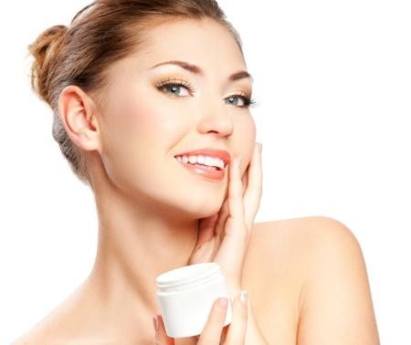 Beautiful spa girl holding jar of cream isolated on white background