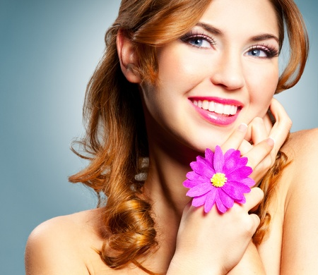 redhaired: Beautiful happy smiling woman with long curly hair