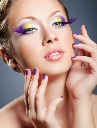 Woman face with bright violet makeup and manicure Stock Photo - 14135179