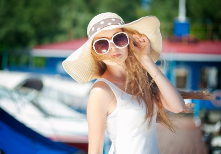 Beautiful young woman in hat outdoors Stock Photo - 14995164