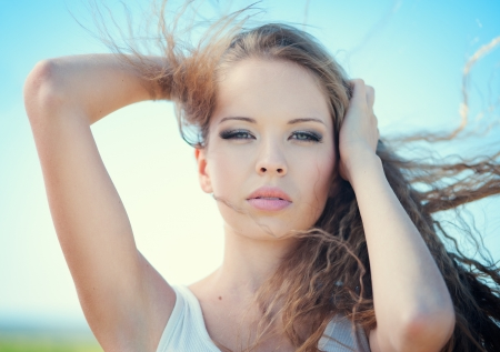 Beautiful fashion girl with curly hair outdoors Stock Photo - 14995166