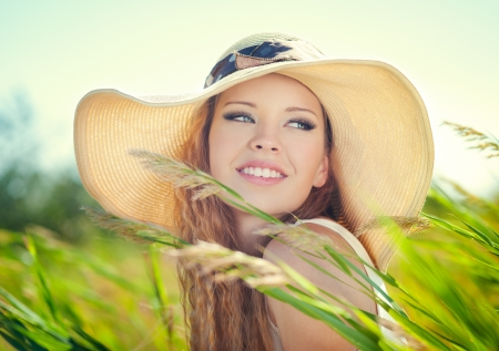 Beautiful woman face on summer meadow Imagens