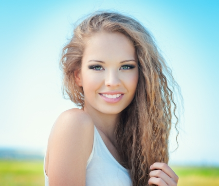 Beautiful smiling girl with long curly hair outdoor Stock Photo - 15127234