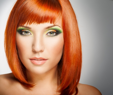 Beautiful Woman with Red Hair and bright makeup Stock fotó