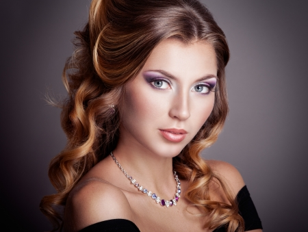 fashion jewelry: Beautiful woman with curly hairstyle