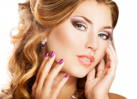 female face closeup: Beautiful woman face with bright makeup and manicure Stock Photo
