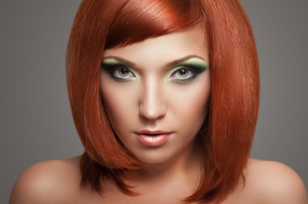 Beautiful Woman with Red Hair and bright makeup Stock Photo