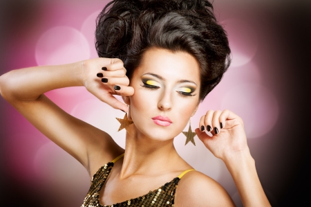 Fashion Disco girl with hairstyle and black nails photo