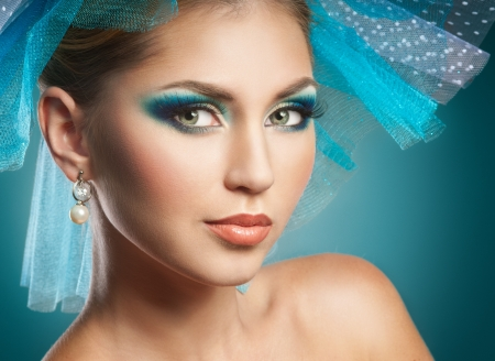 Beautiful woman with blue make-up photo