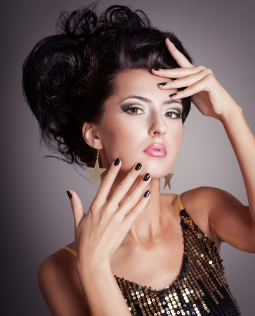 Fashion woman with hairstyle and black nails