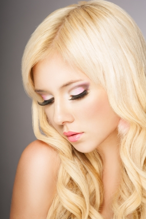 Beautiful blond woman closed eyes, long eyelashes photo
