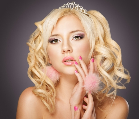 Fashion blond princess woman with pink makeup and manicure, curly hair photo