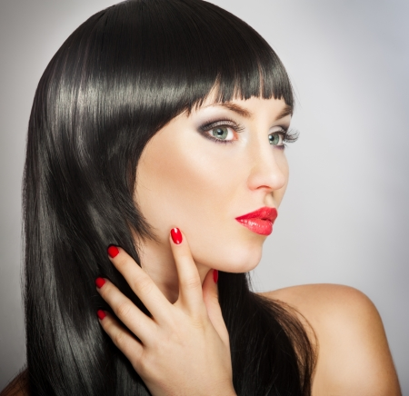 Woman with bright red lips and manicure, black hair Stock Photo - 17383432