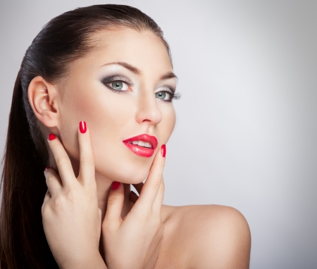 Woman with bright red lips and manicure Stock Photo - 17383428