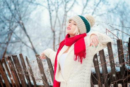 Winter blonde Woman portrait. Beautiful fashion model girl in bright hat and scarf Stock Photo - 17473077